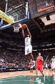 Ronnie Price of the Utah Jazz slam dunks the ball against the Houston Rockets during a game at the EnergySolutions Arena on February 02 2011 in Salt...