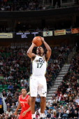 Ronnie Price of the Utah Jazz takes a jump shot against the Houston Rockets during a game at the EnergySolutions Arena on February 02 2011 in Salt...