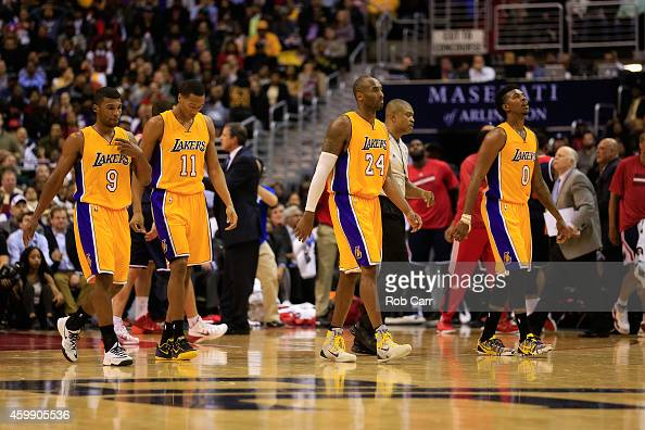 Ronnie Price Wesley Johnson Kobe Bryant and Nick Young of the Los Angeles Lakers walk off the floor during a timeout in the second half of the Lakers...