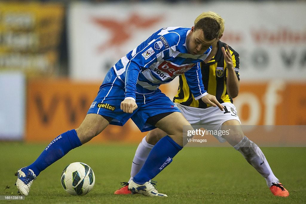 Ronnie Reniers of PEC Zwolle, Michihiro Yasuda of Vitesse during the Dutch Eredivisie match between Vitesse Arnhem and PEC Zwolle at the Gelredome on march 31, 2013 in Arnhem, The Netherlands