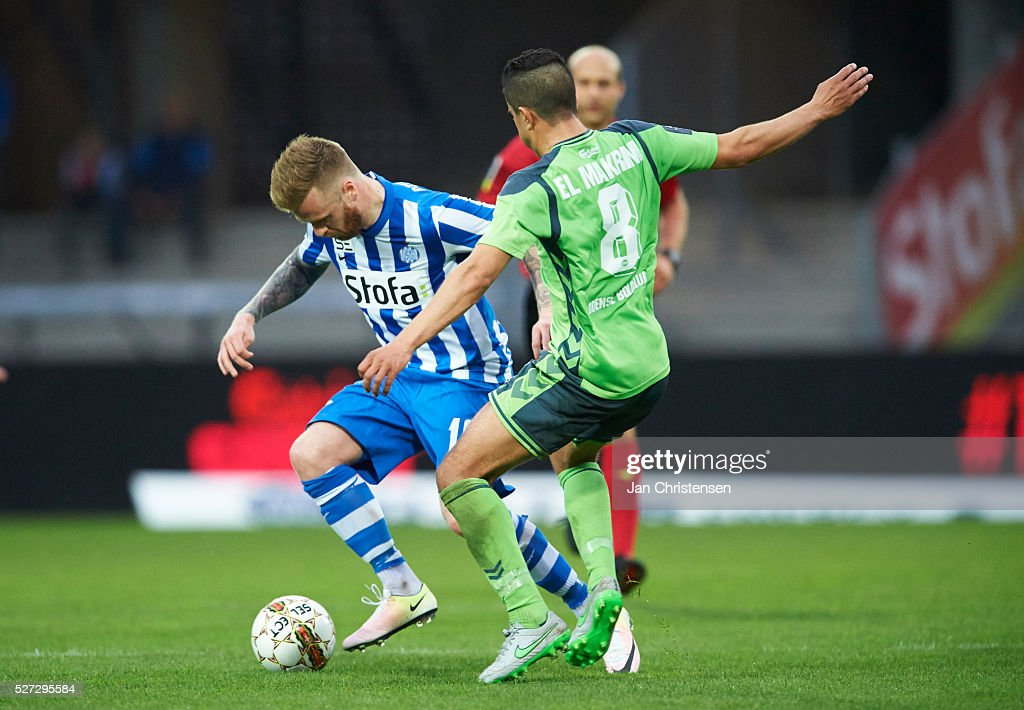 Ronnie Schwartz of Esbjerg fb and Mohamed El Makrini of OB Odense compete for the ball during the Danish Alka Superliga match between Esbjerg fB and OB Odense at Blue Water Arena on May 02, 2016 in Esbjerg, Denmark.