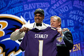 Ronnie Stanley of Notre Dame holds up a jersey with NFL Commissioner Roger Goodell after being picked overall by the Baltimore Ravens during the...