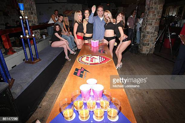 Ronnie 'The Limo Driver' Mund poses with Rick's Cabaret Girls during a filmimg Howard TV On Demand's 'Strip Beer Pong' at Sullivan Hall on February...