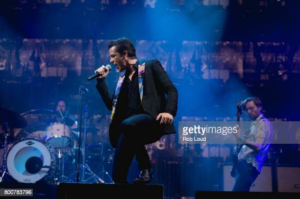 Ronnie Vannucci Brandon Flowers and Mark Stoermer of The Killers performs a surprise concert at Glastonbury Festival Site on June 25 2017 in...