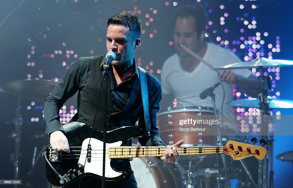 Ronnie Vannucci Jr and Brandon Flowers of The Killers perform on stage at the Melbourne leg of the Good Vibrations music festival at Flemington...