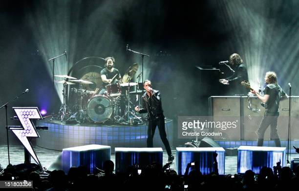 Ronnie Vannucci Jr Brandon Flowers Dave Keuning and Mark Stourmer of The Killers performs on stage during iTunes Festival at The Roundhouse on...