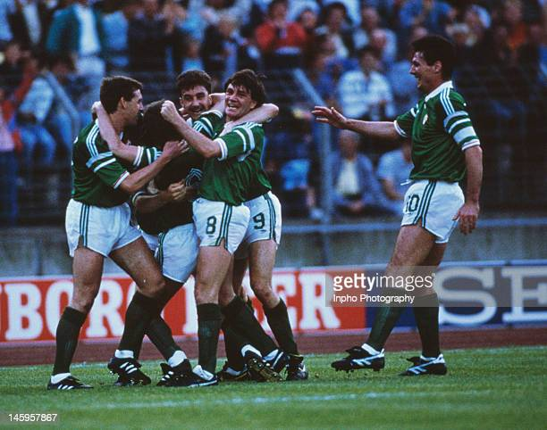 Ronnie Whelan of Republic of Ireland celebrates with teammates after scoring a superb goal during the UEFA European Championships 1988 Group 2 match...
