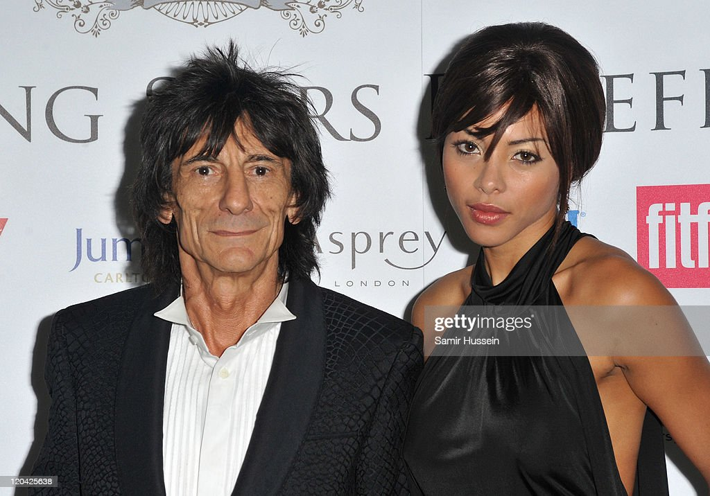 Ronnie Wood and Ana Araujo attend the FitFlop Shooting Stars Benefit Closing Ball following a two-day golf tournament raising vital funds for Make-A-Wish Foundation UK at the Royal Courts of Justice on August 5, 2011 in London, England.