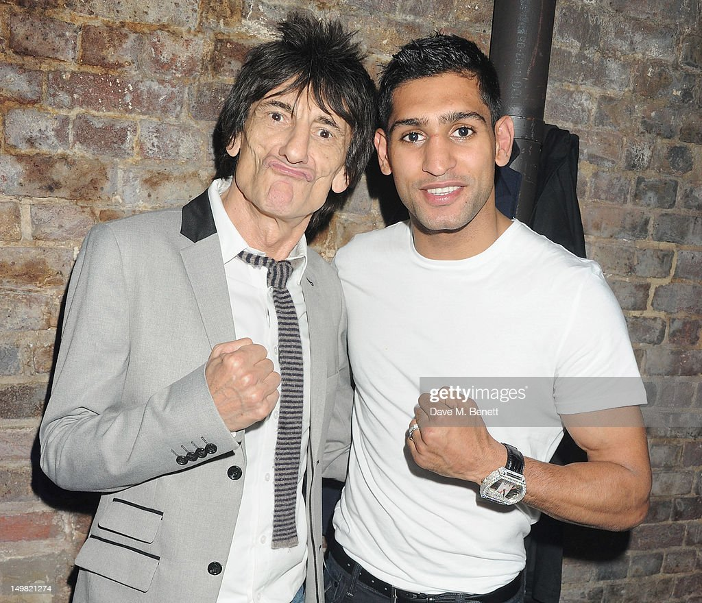 Ronnie Wood (L) and boxer <a gi-track='captionPersonalityLinkClicked' href=/galleries/search?phrase=Amir+Khan+-+Boxer&family=editorial&specificpeople=162795 ng-click='$event.stopPropagation()'>Amir Khan</a> attend a VIP Reception as Glaceau vitaminwater presents 'Jessie J Live In London' at The Roundhouse on August 4, 2012 in London, England.