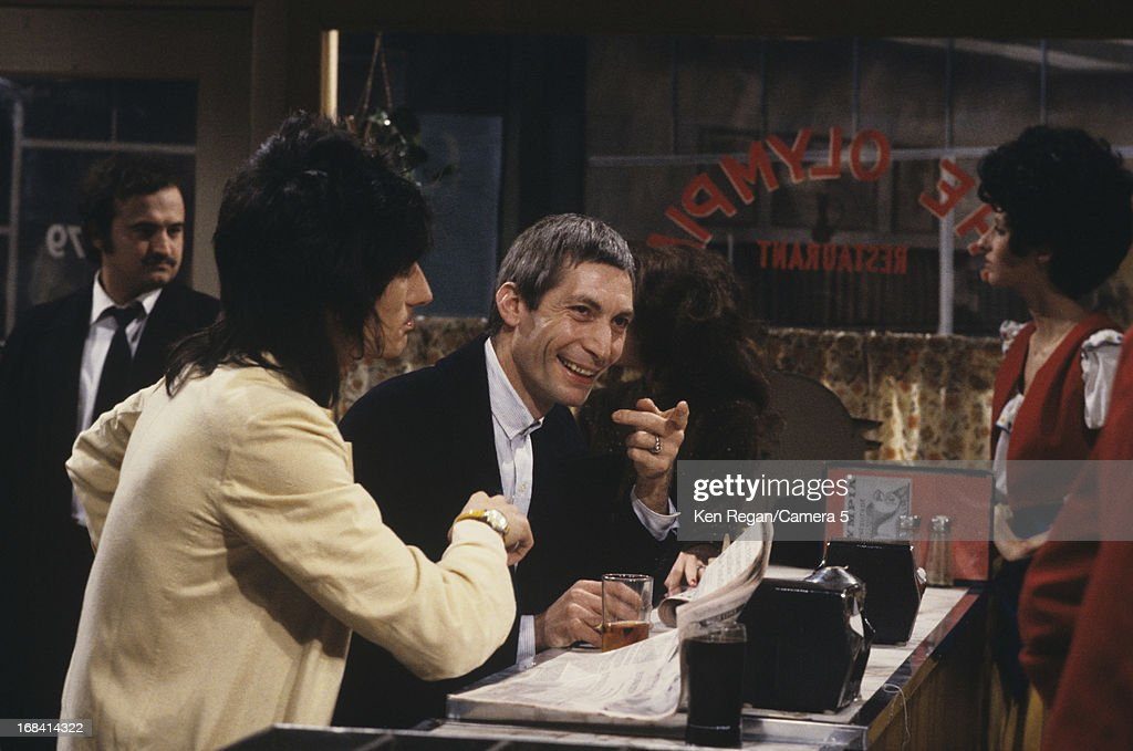 Ronnie Wood and Charlie Watts of the Rolling Stones are photographed on the set of Saturday Night Live on October 7, 1978 in New York City.