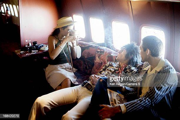 Ronnie Wood and Charlie Watts of the Rolling Stones are photographed with Bianca Jagger on their private plane in 1975 in Kansas City Kansas CREDIT...
