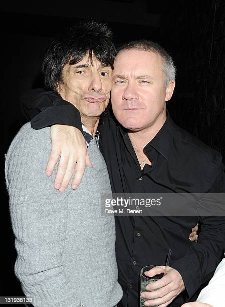 Ronnie Wood and Damien Hirst attend the launch of Flea and Damien Hirst's new line of Spin Bass Guitar at Club Nouveau in Mayfair's The Arts Club on...