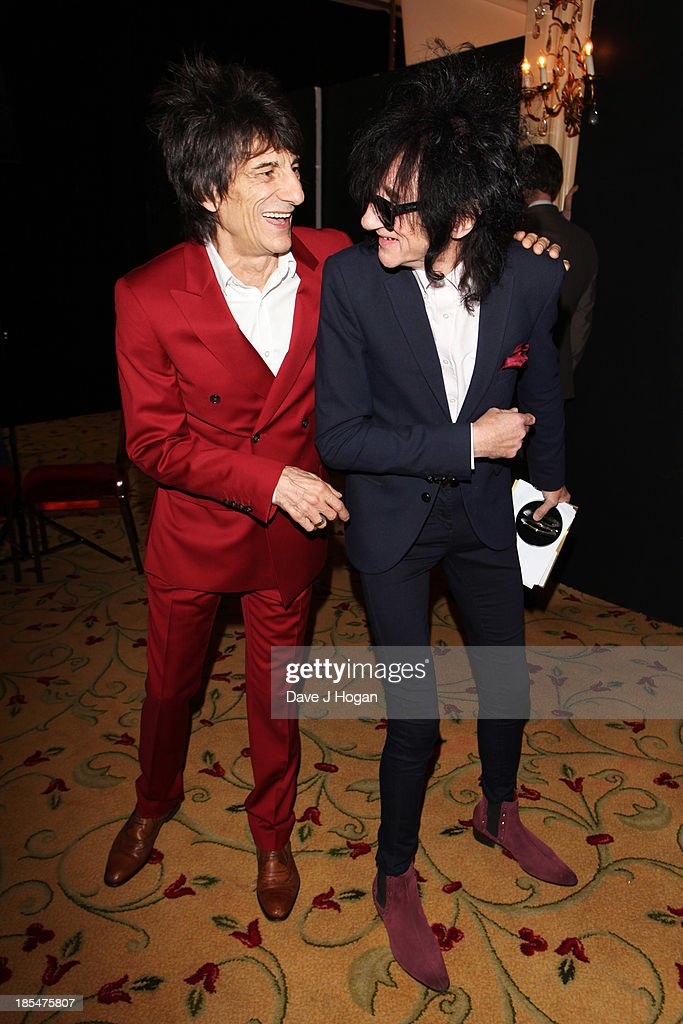 Ronnie Wood and <a gi-track='captionPersonalityLinkClicked' href=/galleries/search?phrase=John+Cooper+Clarke&family=editorial&specificpeople=2375452 ng-click='$event.stopPropagation()'>John Cooper Clarke</a> pose in the press room at The Q Awards 2013 at Grosvenor House on October 21, 2013 in London, England.