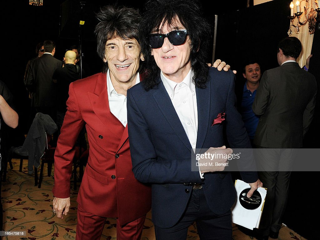 Ronnie Wood (L) and <a gi-track='captionPersonalityLinkClicked' href=/galleries/search?phrase=John+Cooper+Clarke&family=editorial&specificpeople=2375452 ng-click='$event.stopPropagation()'>John Cooper Clarke</a>, winner of the Poet Laureate award, pose in the press room at The Q Awards at The Grosvenor House Hotel on October 21, 2013 in London, England.