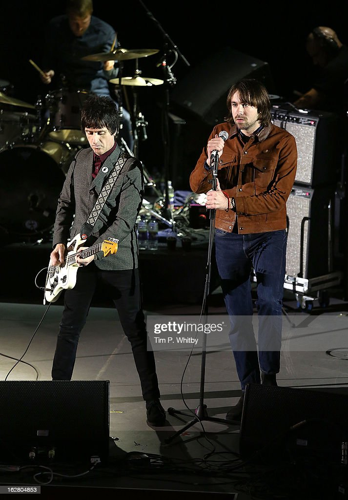 Ronnie Wood and Justin Young of The Vaccines perform at the NME Awards 2013 at the Troxy on February 27, 2013 in London, England.