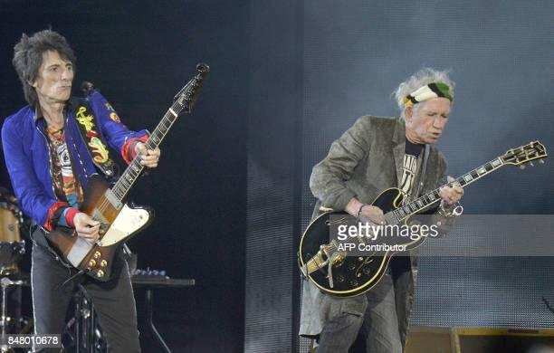 Ronnie Wood and Keith Richards of 'The Rolling Stones' perform during a concert on September 16 in Spielberg / AFP PHOTO / APA / HERBERT PFARRHOFER /...