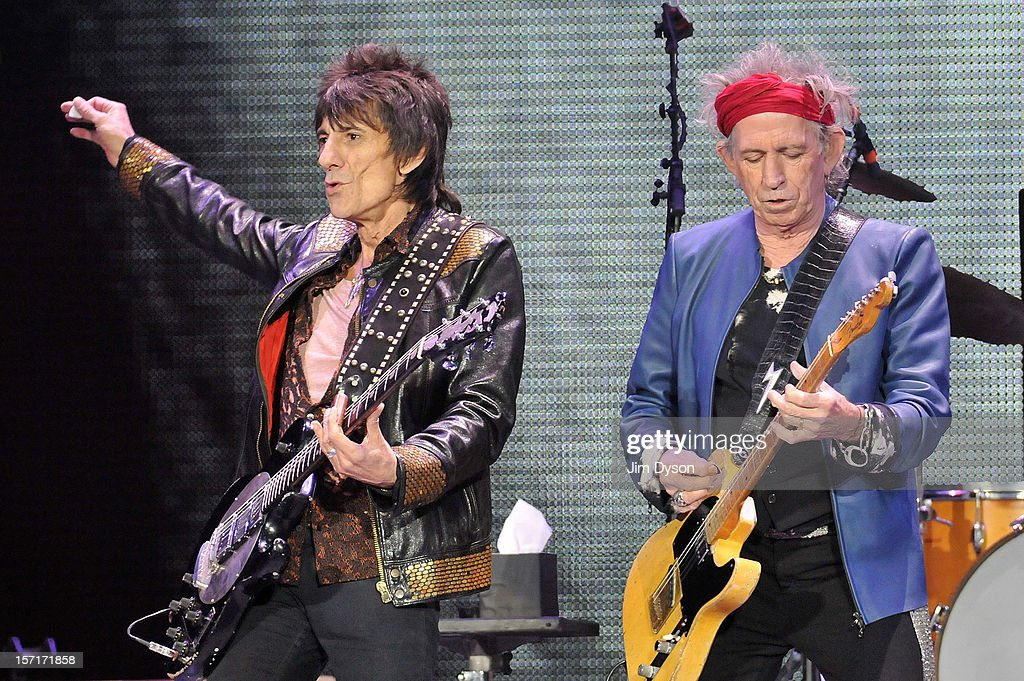 Ronnie Wood and Keith Richards of The Rolling Stones perform live on stage, during their 50th anniversary tour at O2 Arena on November 29, 2012 in London, England.