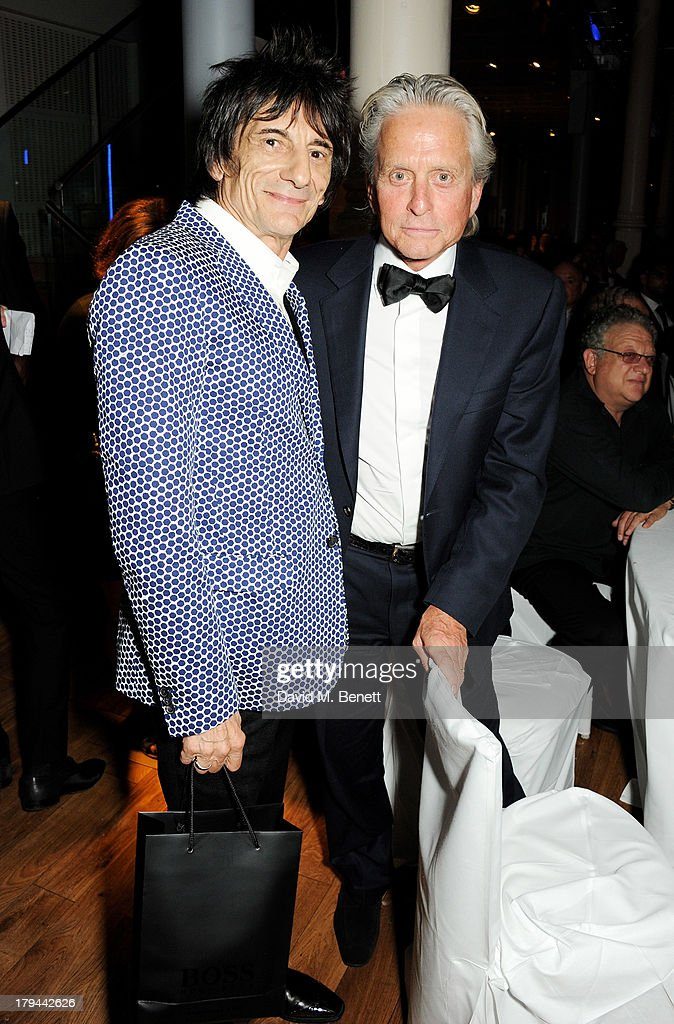 Ronnie Wood (L) and Michael Douglas attend the GQ Men of the Year awards at The Royal Opera House on September 3, 2013 in London, England.