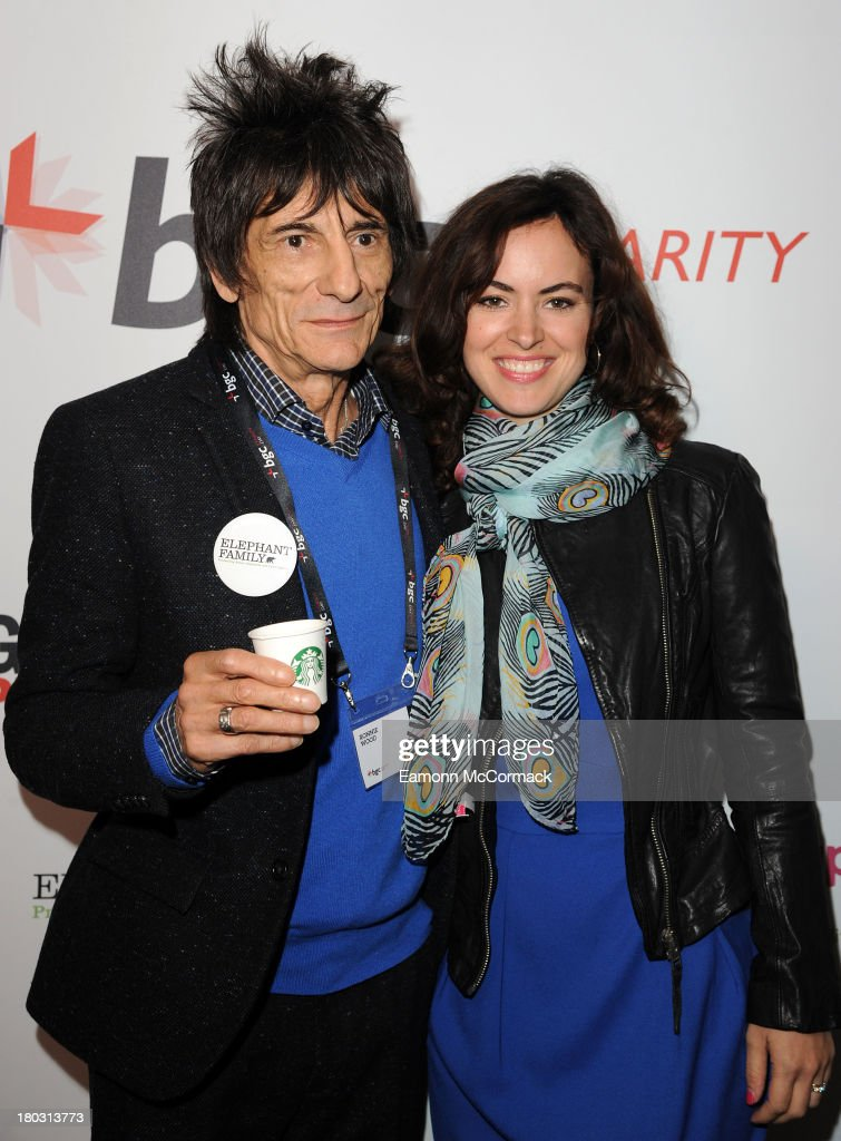 Ronnie Wood (L) and Sally Humphreys attend the BGC Partners charity day at Canary Wharf on September 11, 2013 in London, England.