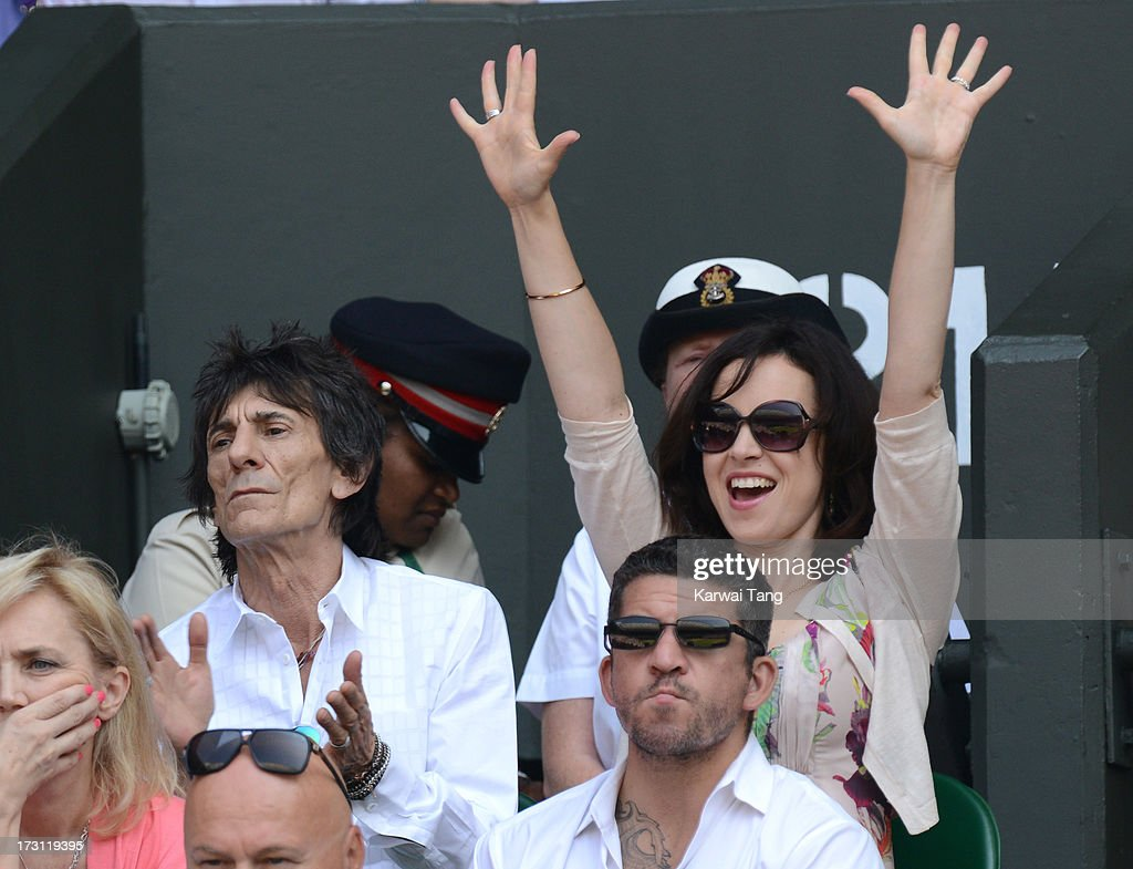 Ronnie Wood and <a gi-track='captionPersonalityLinkClicked' href=/galleries/search?phrase=Sally+Humphreys&family=editorial&specificpeople=9192388 ng-click='$event.stopPropagation()'>Sally Humphreys</a> attend the Mens Singles Final on Day 13 of the Wimbledon Lawn Tennis Championships at the All England Lawn Tennis and Croquet Club on July 7, 2013 in London, England.