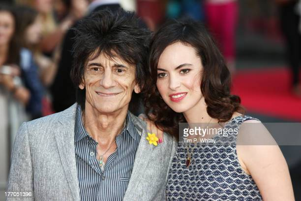 Ronnie Wood and Sally Humphreys attend the World Premiere of 'One Direction This Is Us' at Empire Leicester Square on August 20 2013 in London England
