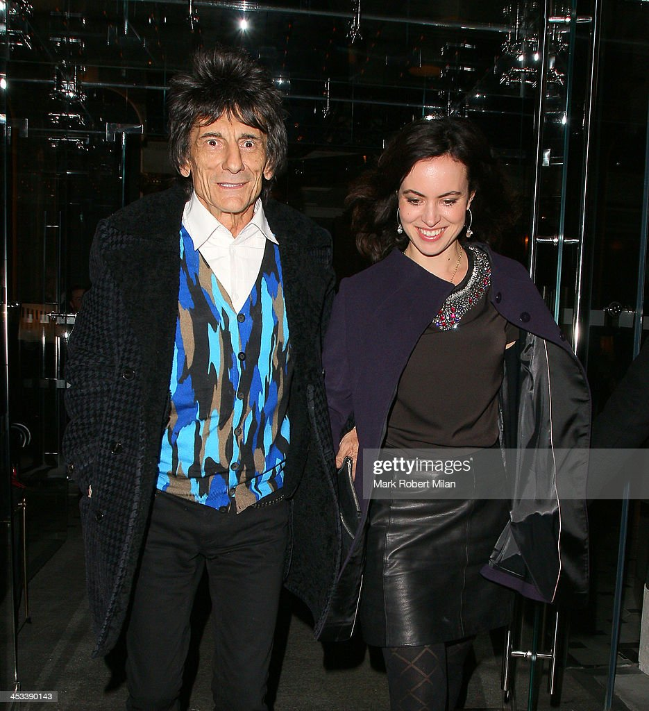 Ronnie Wood and <a gi-track='captionPersonalityLinkClicked' href=/galleries/search?phrase=Sally+Humphreys&family=editorial&specificpeople=9192388 ng-click='$event.stopPropagation()'>Sally Humphreys</a> leaving Berners Grill restaurant on December 3, 2013 in London, England.