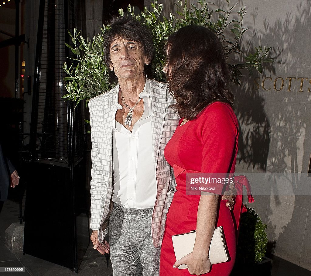 Ronnie Wood and Sally Humphreys leaving Scotts Restaurant, Mayfair on July 11, 2013 in London, England.