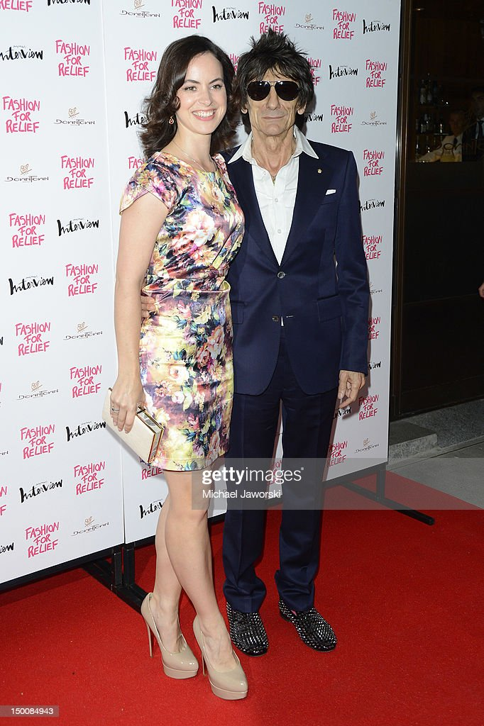 Ronnie Wood and Sally Humphries attend Fashion for Relief charity dinner on August 9, 2012 in London, England.