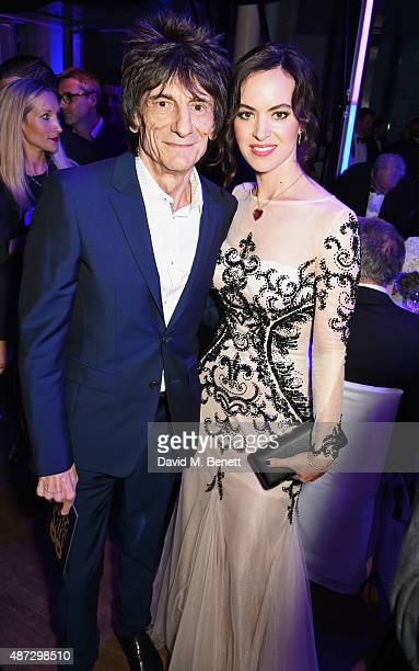 Ronnie Wood and Sally Wood attend the GQ Men Of The Year Awards at The Royal Opera House on September 8 2015 in London England