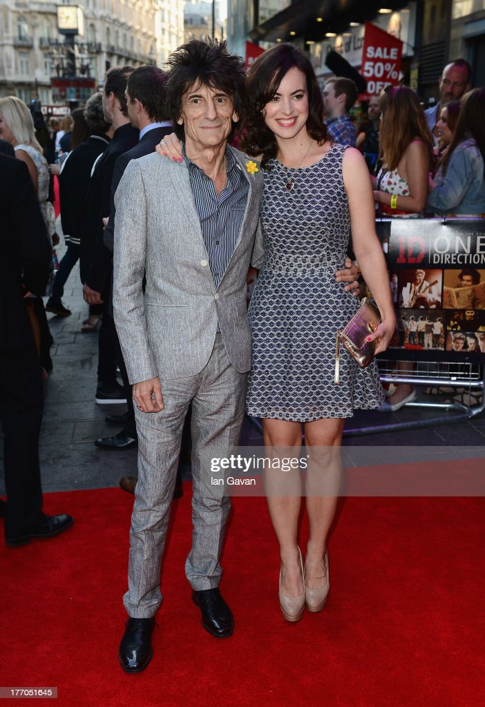 Ronnie Wood and Sally Wood attend the 'One Direction This Is Us' world premiere at the Empire Leicester Square on August 20, 2013 in London, England.