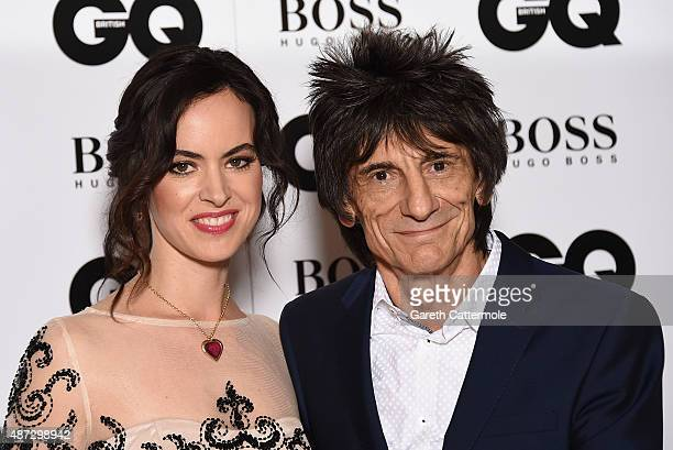 Ronnie Wood and wife Sally Humphreys attend the GQ Men Of The Year Awards at The Royal Opera House on September 8 2015 in London England