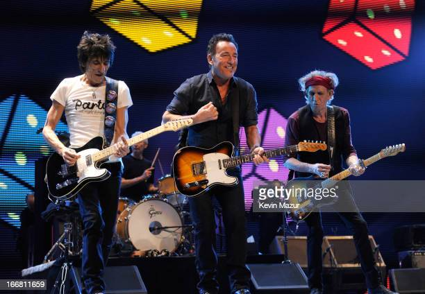 Ronnie Wood Bruce Springsteen and Keith Richards of The Rolling Stones perform at the Prudential Center on December 15 2012 in Newark New Jersey The...