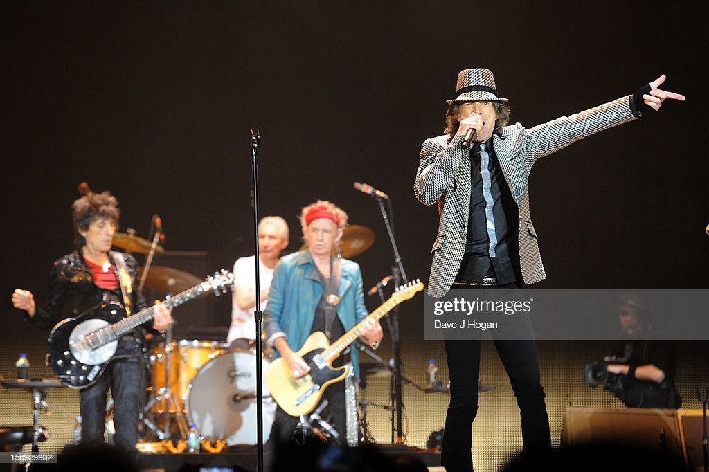 Ronnie Wood, Keith Richards and Mick Jagger of the Rolling Stones perform at 02 Arena on November 25, 2012 in London, England.