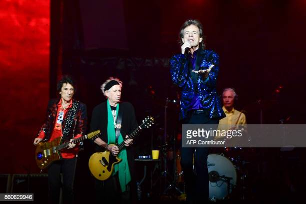 Ronnie Wood Keith Richards Mick Jagger and Charlie Watts of the band The Rolling Stones Mick Jagger perform on stage at the Friends Arena in...