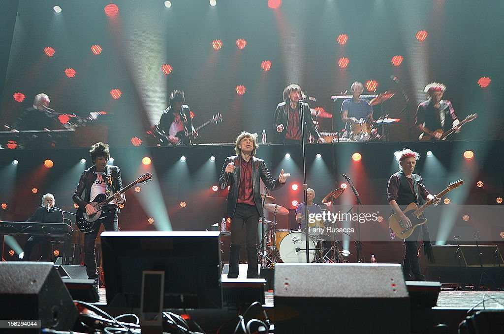 Ronnie Wood, Mick Jagger, and Keith Richards of The Rolling Stones perform at '12-12-12' a concert benefiting The Robin Hood Relief Fund to aid the victims of Hurricane Sandy presented by Clear Channel Media & Entertainment, The Madison Square Garden Company and The Weinstein Company at Madison Square Garden on December 12, 2012 in New York City.