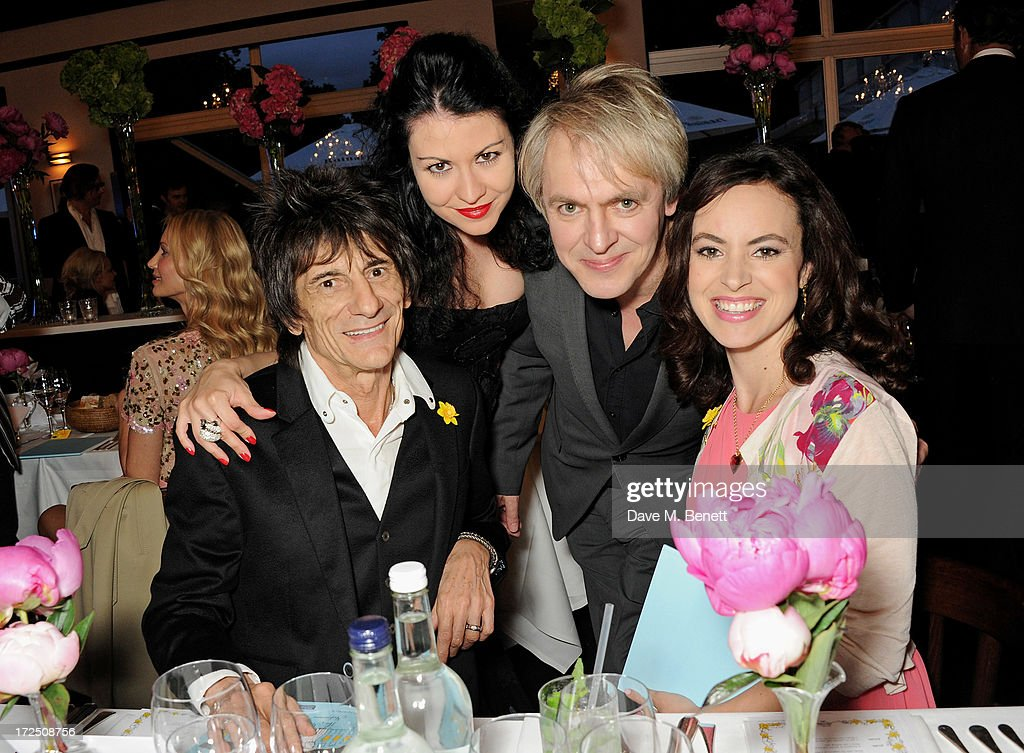 Ronnie Wood, Nefer Suvio, <a gi-track='captionPersonalityLinkClicked' href=/galleries/search?phrase=Nick+Rhodes&family=editorial&specificpeople=206732 ng-click='$event.stopPropagation()'>Nick Rhodes</a> and Sally Wood attend The Masterpiece Midsummer Party in aid of Marie Curie Cancer Care, hosted by Heather Kerzner, at The Royal Hospital Chelsea on July 2, 2013 in London, England. Marie Curie Nurses provide free end of life care to patients with terminal illness in their own homes or in one of its nine hospices.