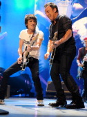 Ronnie Wood of The Rolling Stones and Bruce Springsteen perform at the Prudential Center on December 15 2012 in Newark New Jersey The Rolling Stones...