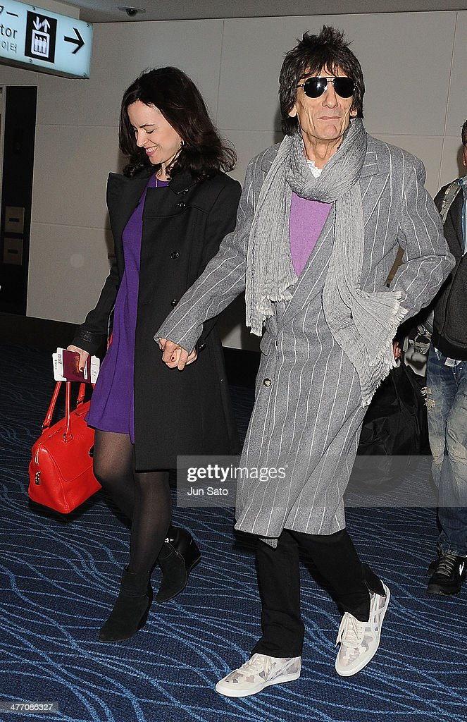 Ronnie Wood of the Rolling Stones and <a gi-track='captionPersonalityLinkClicked' href=/galleries/search?phrase=Sally+Humphreys&family=editorial&specificpeople=9192388 ng-click='$event.stopPropagation()'>Sally Humphreys</a> are seen upon departure at Haneda Airport on March 7, 2014 in Tokyo, Japan.