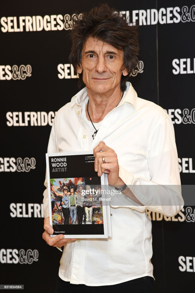 Ronnie Wood poses with a copy of his new book 'Ronnie Wood: Artist' at Selfridges on August 15, 2017 in London, England.