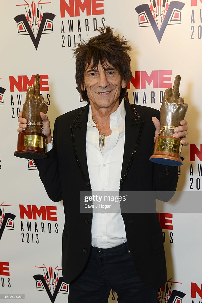Ronnie Wood poses with the Best Live Band and Best Music Film Awards in the media room at the NME Awards 2013 at The Troxy on February 27, 2013 in London, England.