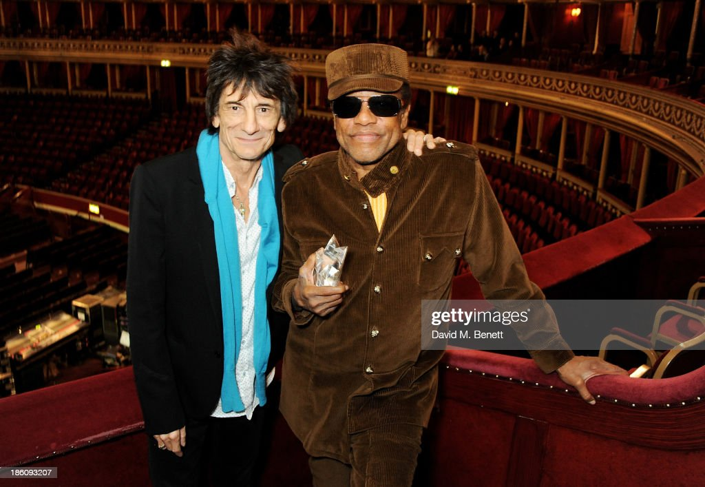 Ronnie Wood (L) presents Bobby Womack with the 'Bluesfest Lifetime Achievement Award' for services to soul ahead of their upcoming Bluesfest performance at the Royal Albert Hall on October 28, 2013 in London, England.