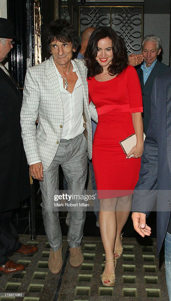 Ronnie Wood, Sally Humphreys and <a gi-track='captionPersonalityLinkClicked' href=/galleries/search?phrase=Charlie+Watts&family=editorial&specificpeople=213325 ng-click='$event.stopPropagation()'>Charlie Watts</a> at Scott's restaurant on July 11, 2013 in London, England.