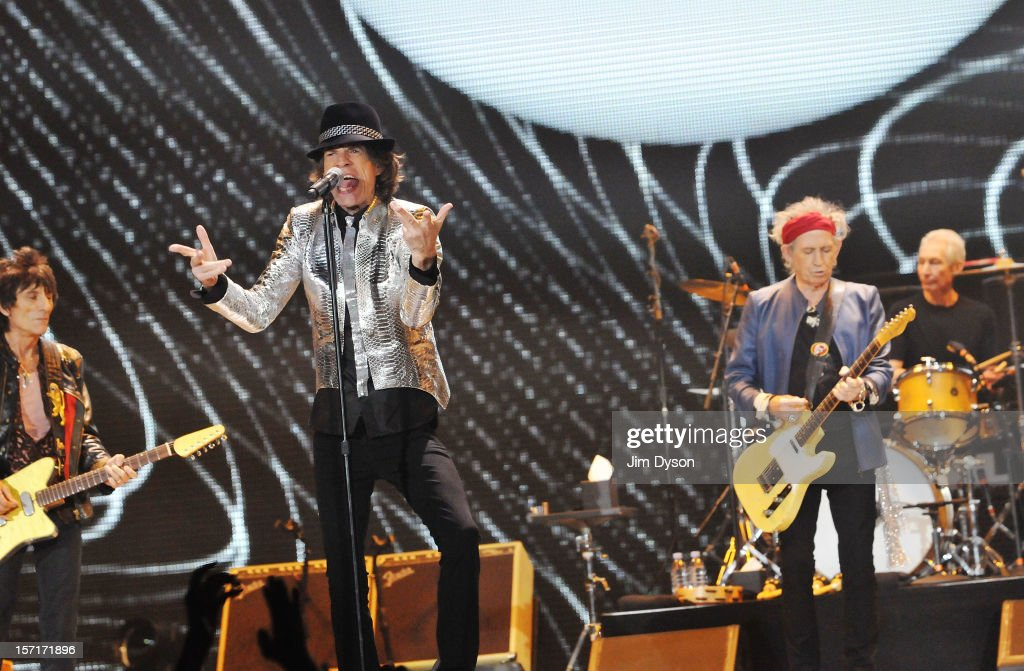 Ronnie Wood, Sir <a gi-track='captionPersonalityLinkClicked' href=/galleries/search?phrase=Mick+Jagger&family=editorial&specificpeople=201786 ng-click='$event.stopPropagation()'>Mick Jagger</a>, <a gi-track='captionPersonalityLinkClicked' href=/galleries/search?phrase=Keith+Richards+-+M%C3%BAsico&family=editorial&specificpeople=202882 ng-click='$event.stopPropagation()'>Keith Richards</a> and <a gi-track='captionPersonalityLinkClicked' href=/galleries/search?phrase=Charlie+Watts&family=editorial&specificpeople=213325 ng-click='$event.stopPropagation()'>Charlie Watts</a> of The Rolling Stones perform live on stage, during their 50th anniversary tour at O2 Arena on November 29, 2012 in London, England.