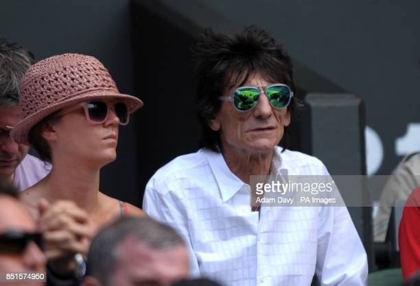 Ronnie Wood watches Great Britain's Andy Murray against Serbia's Novak Djokovic in the stands on day thirteen of the Wimbledon Championships at The...