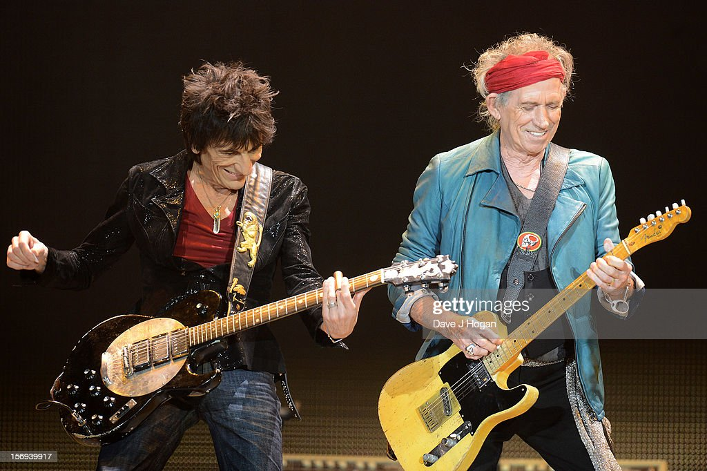 Ronnie Woods and <a gi-track='captionPersonalityLinkClicked' href=/galleries/search?phrase=Keith+Richards+-+Musician&family=editorial&specificpeople=202882 ng-click='$event.stopPropagation()'>Keith Richards</a> of the Rolling Stones perform at 02 Arena on November 25, 2012 in London, England.
