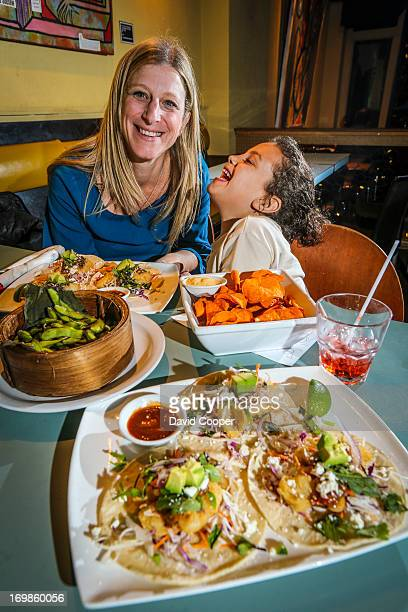 TORONTO ON OCTOBER 27 RonniLyn Pustil and her daughter Lily Eklove 6 having a glutenfree dinner at Supermarket restaurant October 26 2012 DAVID...