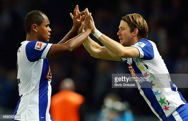 Ronny and Peter Niemeyer of Hertha BSC celebrate during the Hertha BSC v VfL Wolfsburg Bundesliga match at Olympiastadion on September 24 2014 in...