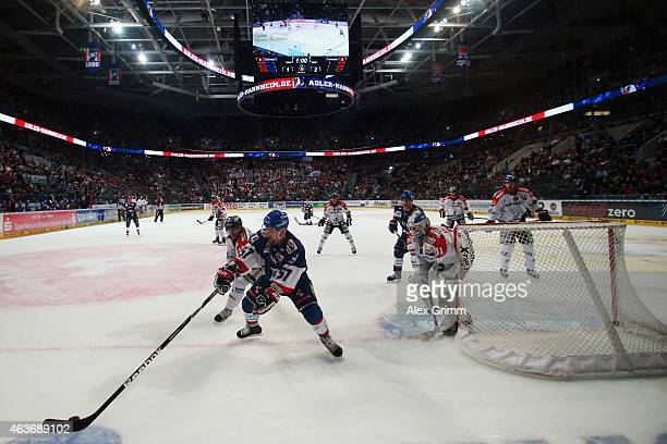 Ronny Arendt of Mannheim is challenged by Jens Baxmann of Berlin during the DEL match between Adler Mannheim and Eisbaeren Berlin at SAP Arena on...