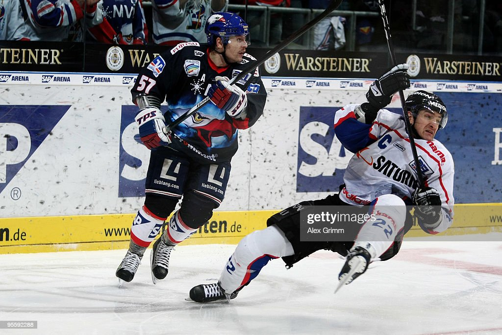 Ronny Arendt of Mannheim is challenged by Michael Bakos of Ingolstadt during the DEL match between Adler Mannheim and ERC Ingolstadt at the SAP Arena...