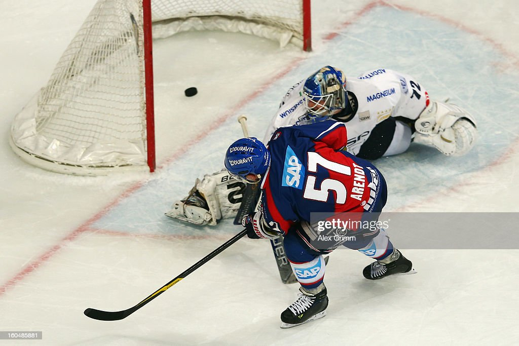 Ronny Arendt of Mannheim scores his team's second goal with a penalty against goalkeeper <a gi-track='captionPersonalityLinkClicked' href=/galleries/search?phrase=Rob+Zepp&family=editorial&specificpeople=3121630 ng-click='$event.stopPropagation()'>Rob Zepp</a> of Berlin during the DEL match between Adler Mannheim and Eisbaeren Berlin at SAP Arena on February 1, 2013 in Mannheim, Germany.